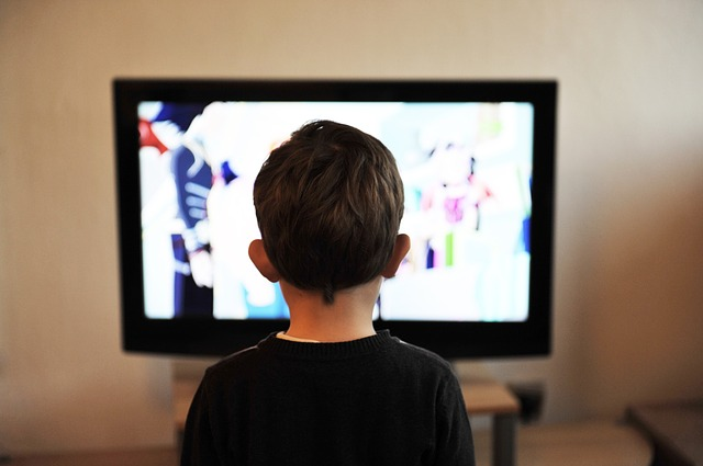 kid watching tv advertisement